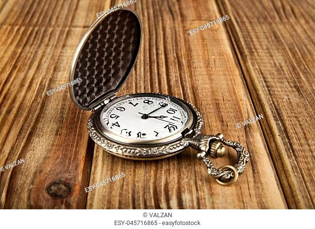 the old clock on wooden background