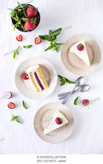 Slices of a strawberry and vanilla cake (seen from above)