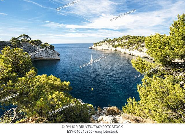 Beautiful nature of Calanques on the azure coast of France. Calanques - a deep bay surrounded by high cliffs. Boat leaves from bay to open sea