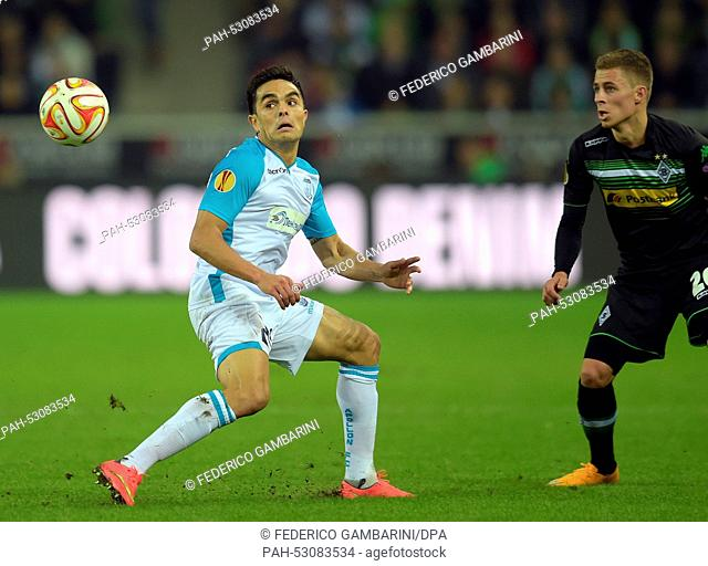 Gladbach's Thorgan Hazard (R) and Limassol's Bertrand Robert vie for the ball during the Europa League group A match between Borussia Moenchengladbach and...