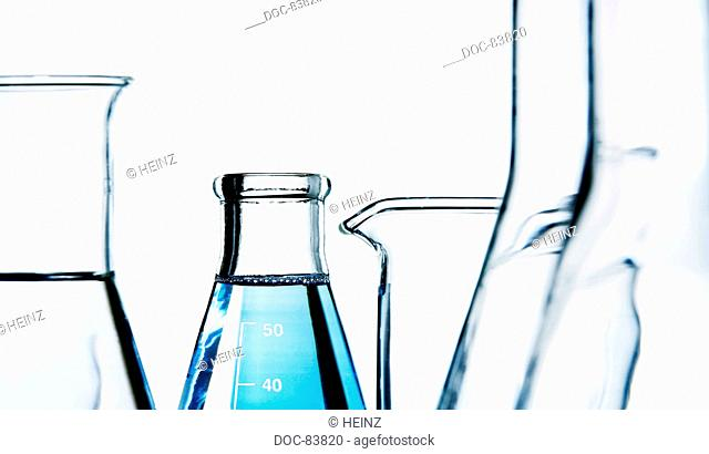 different laboratory glasses, full and empty