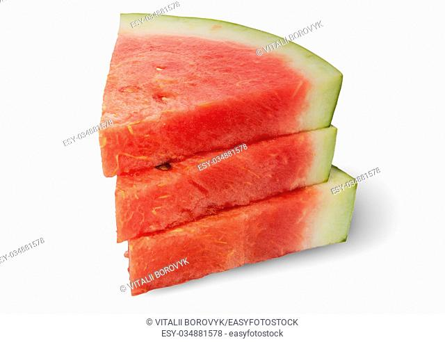 Stack of three pieces of ripe red watermelon isolated on white background