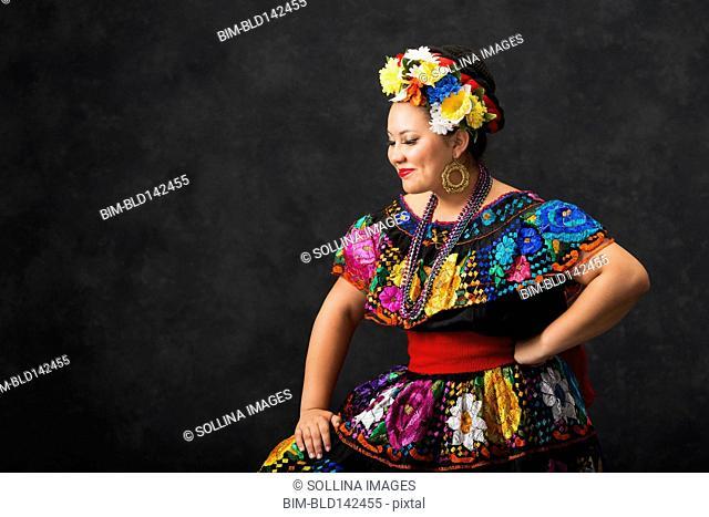 Hispanic woman dancing in Chiapas Folkloric dress