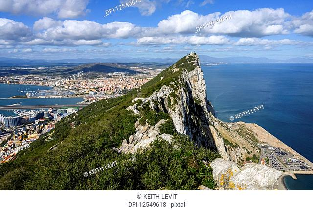View of the coastline of Gibraltar with the peaked rock formation in the foreground; Gibraltar