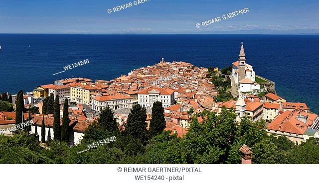 Panorama of Cape Madonna at Point of Piran Slovenia on blue Adriatic Sea with Tartini Square courthouse City Hall and St George's Catholic church