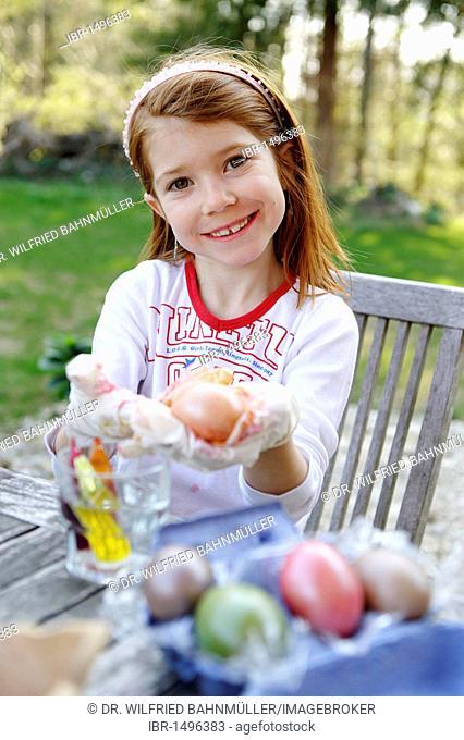 Girl painting easter eggs, Easter preparation