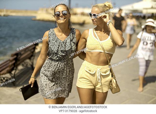 two women walking in Chania, Crete, Greece