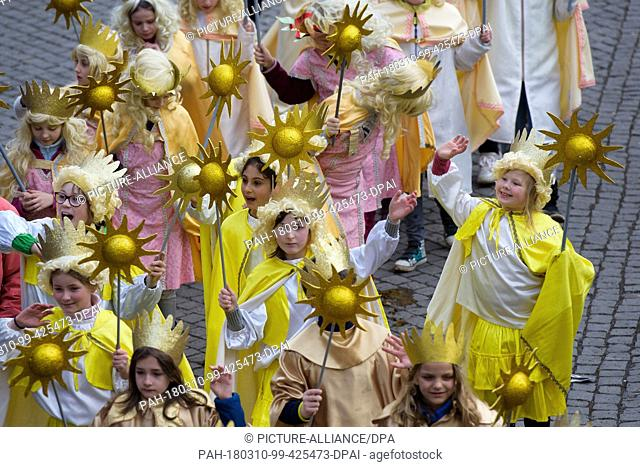 10 March 2018, Germany, Eisenach: The 'Eisenacher Sommergewinn' parade celebrates the beginning of spring and is listed as one of UNESCO's intangible cultural...