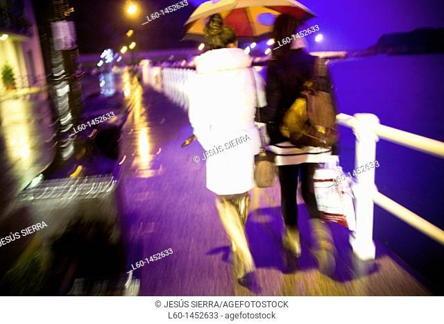 Girls walking in Cudillero, Asturias, Spain