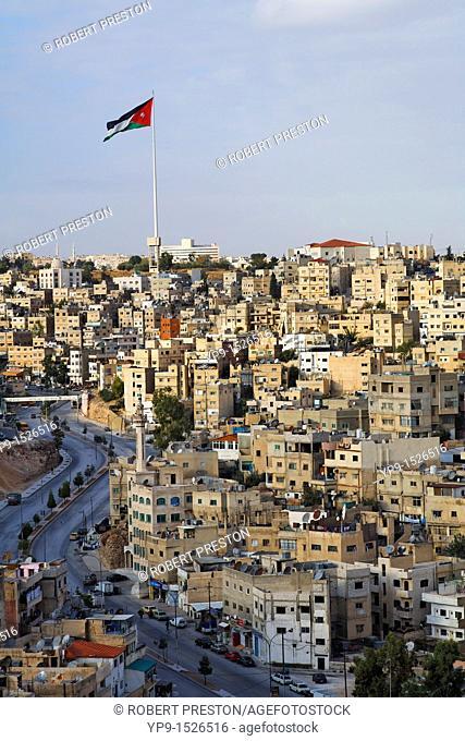 Lareg Jordanian flag flying over the city of Amman, Jordan