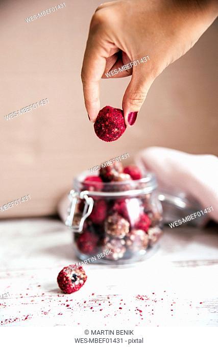 Hand taking energy ball