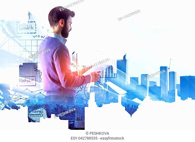 Businessman in modern office interior with abstract business sketch hologram. Success and management concept. Double exposure