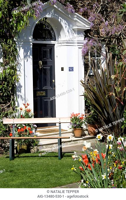 Entrance door to a large house surrounded by vegetation, St John's Wood, London, NW8, England