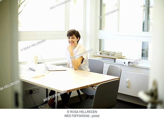 Portrait of smiling architect in her office