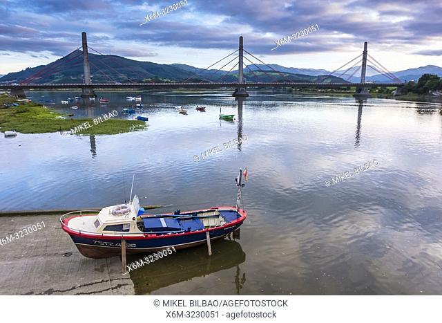 Bridge, boat and Ason river. Santoña, Victoria and Joyel Marshes Natural Park. Colindres, Cantabria, Spain, Europe