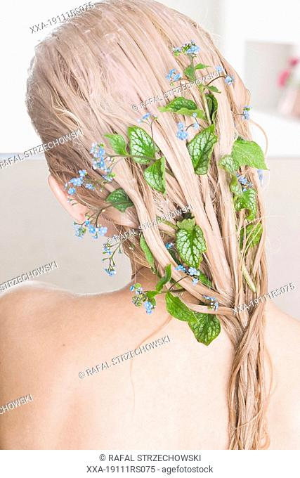 woman with herbal hair mask