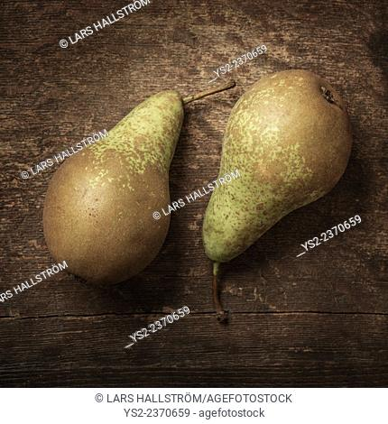 Still life of fresh pears on wooden surface