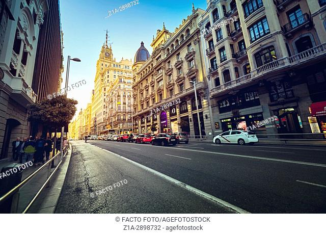 View of Gran V'a Street at golden hour. Madrid. Spain