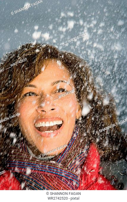 Woman laughing in the snow