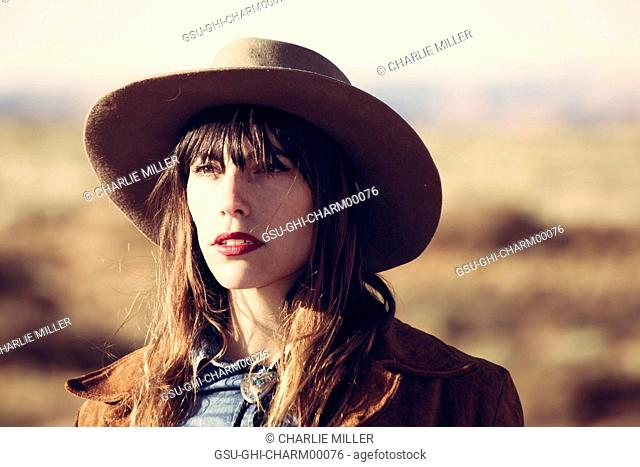 Portrait of Young Adult Woman in Cowboy Hat and Red Lipstick