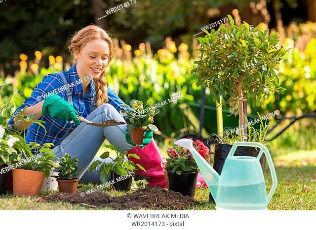 Happy blonde gardening