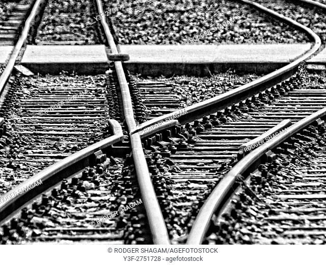 Black and white image of a railroad intersection. The line point changes the direction of the train to branch off somewhere else