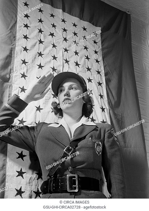 Female Guard Saluting Before Company Service Flag during World War II, Bendix Aviation Plant, Brooklyn, New York, USA, Ann Rosener for Office of War Information