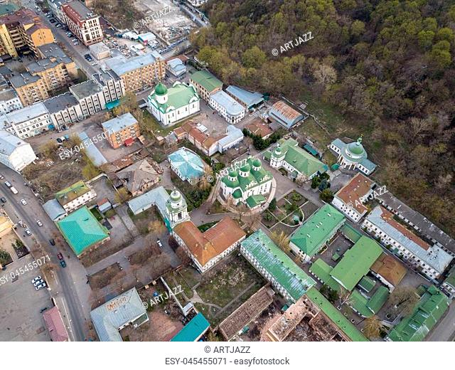 Aerial panoramic view from the drone to the oldest district of Kiev - Podol with the Frolovsky Monastery and old buildings, chuches and other historical places