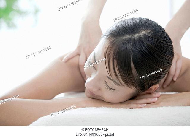 Woman getting a massage, Tokyo Prefecture, Japan