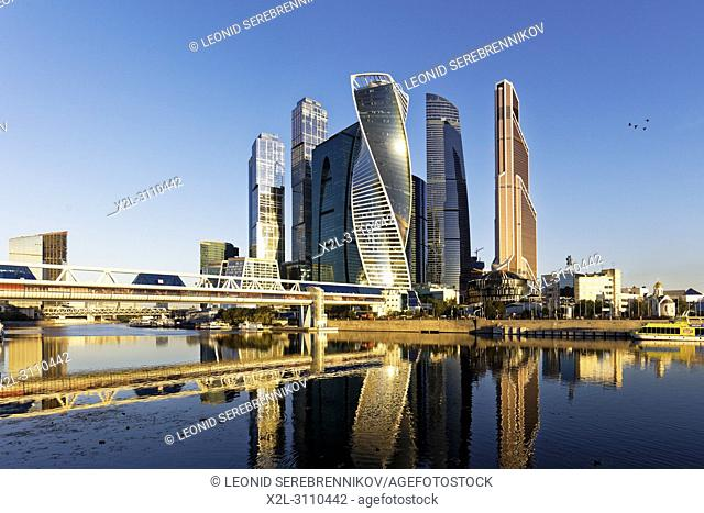 High rise buildings of Moscow International Business Centre (MIBC) and Bagration pedestrian bridge at sunrise. Moscow, Russia