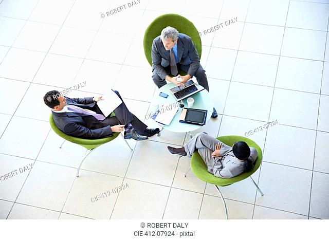 High angle view of business people meeting in lobby