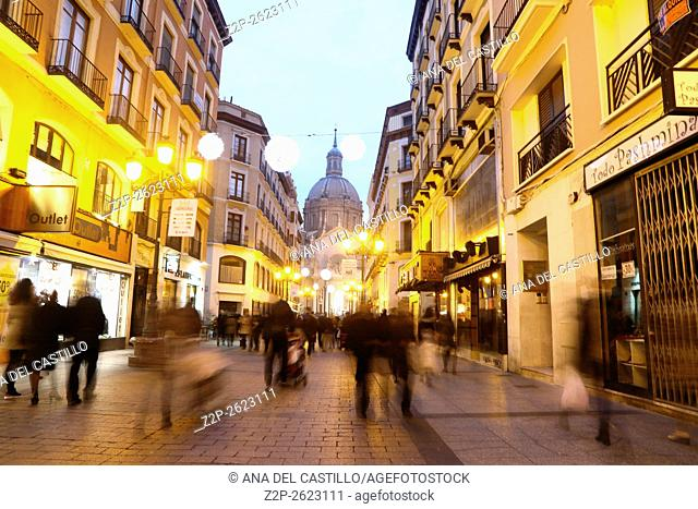 ZARAGOZA, SPAIN- JANUARY 1, 2016: People walking down the boulevard Alfonso I to plaza del Pilar. Nightscape