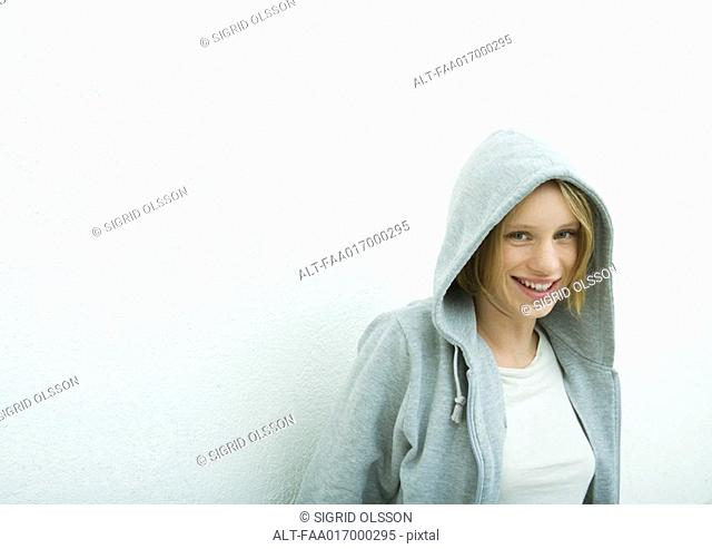Teenage girl wearing hood, portrait