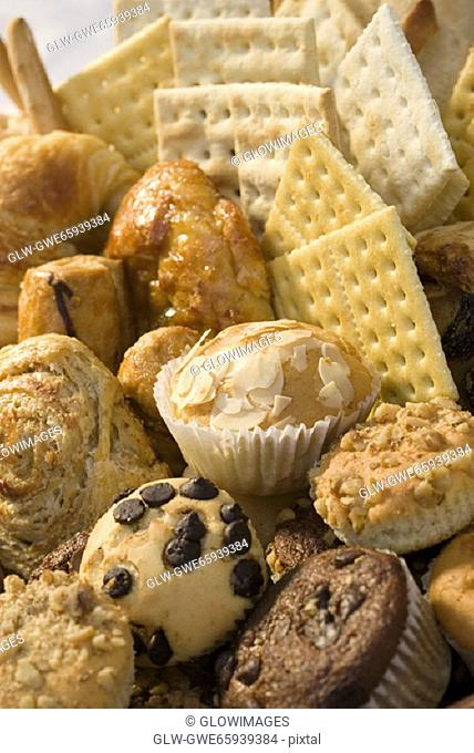 High angle view of muffins and crackers in a wicker basket