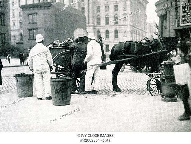 In this photograph, dating to 1915, city employees of Chicago, Illinois, gather the cans into which residents were required to put their garbage