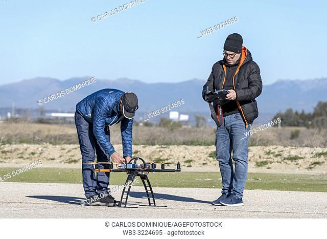 Professional drone being prepared by pilot assistant