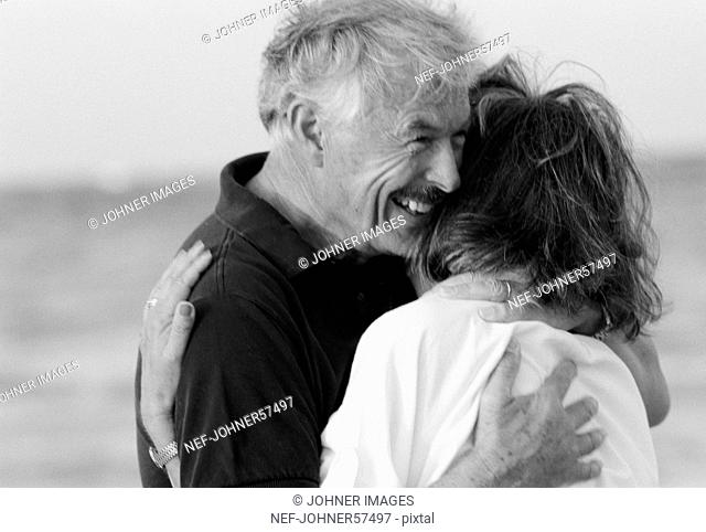 A middle-aged couple embracing each other