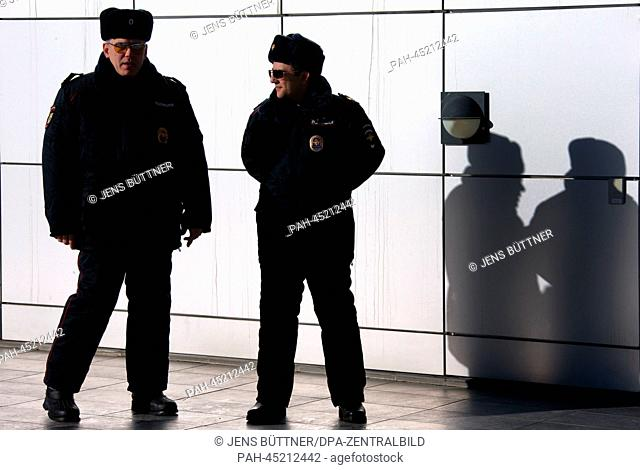 Policemen stand in front of the Laura Biathlon & Ski Complex in Krasnaya Polyana, Russia, 18 December 2013. Sochi will host the Winter Olympic Games from 07 to...