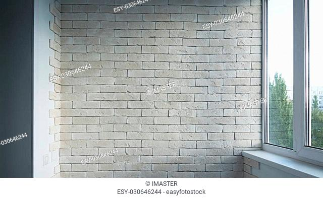Vintage interior of white brick wall and old wooden floor