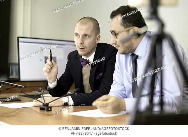 concentrated business men debating arguments at conference, in office, in Cottbus, Brandenburg, Germany