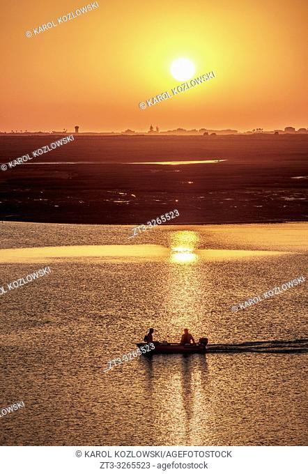 View towards Ria Formosa Natural Park at sunset, Faro, Algarve, Portugal