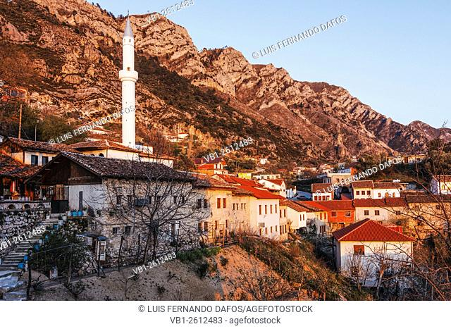 Old bazaar houses and minaret by the mountains at Kruja, Albania