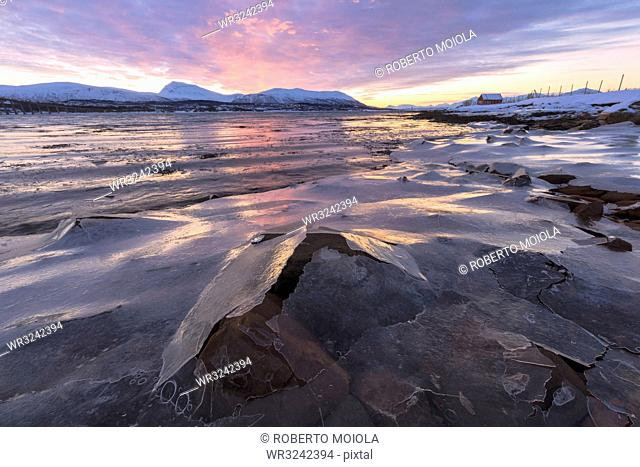 Sunset on rocks covered with ice, Troms, Norway, Scandinavia, Europe