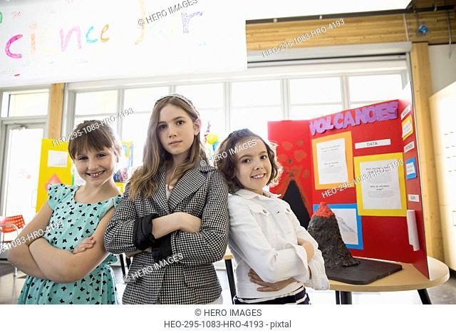 Portrait of confident school girls at science fair