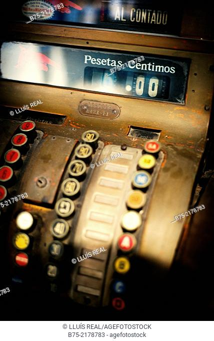 Vintage cash register in a pastry Calle de la Pincesa in Barcelona, Spain, Europe. With a text: cash, pesetas and cents