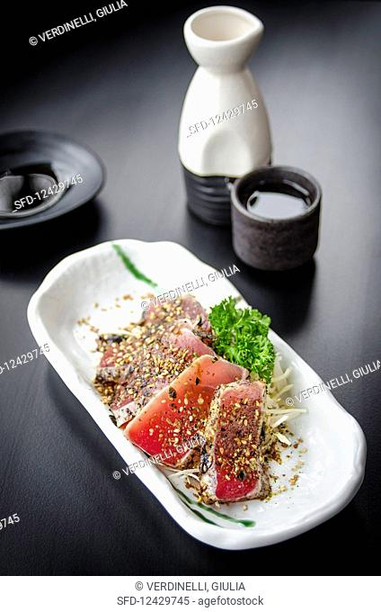 Japanese maguro tataki (seared tuna fillets covered in chopped nori and sesame seeds with a light shoyu based dressing)
