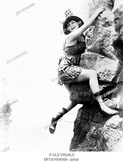 Portrait of woman climbing rock cliff All persons depicted are not longer living and no estate exists Supplier warranties that there will be no model release...