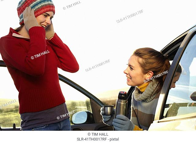 Women drinking coffee from thermos