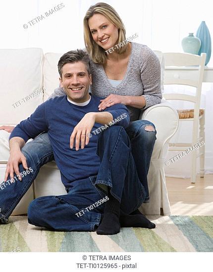 Couple hugging in livingroom