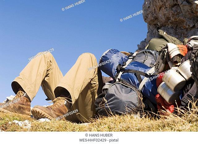 Austria, Salzburg County, Person taking a break next to hiking gear